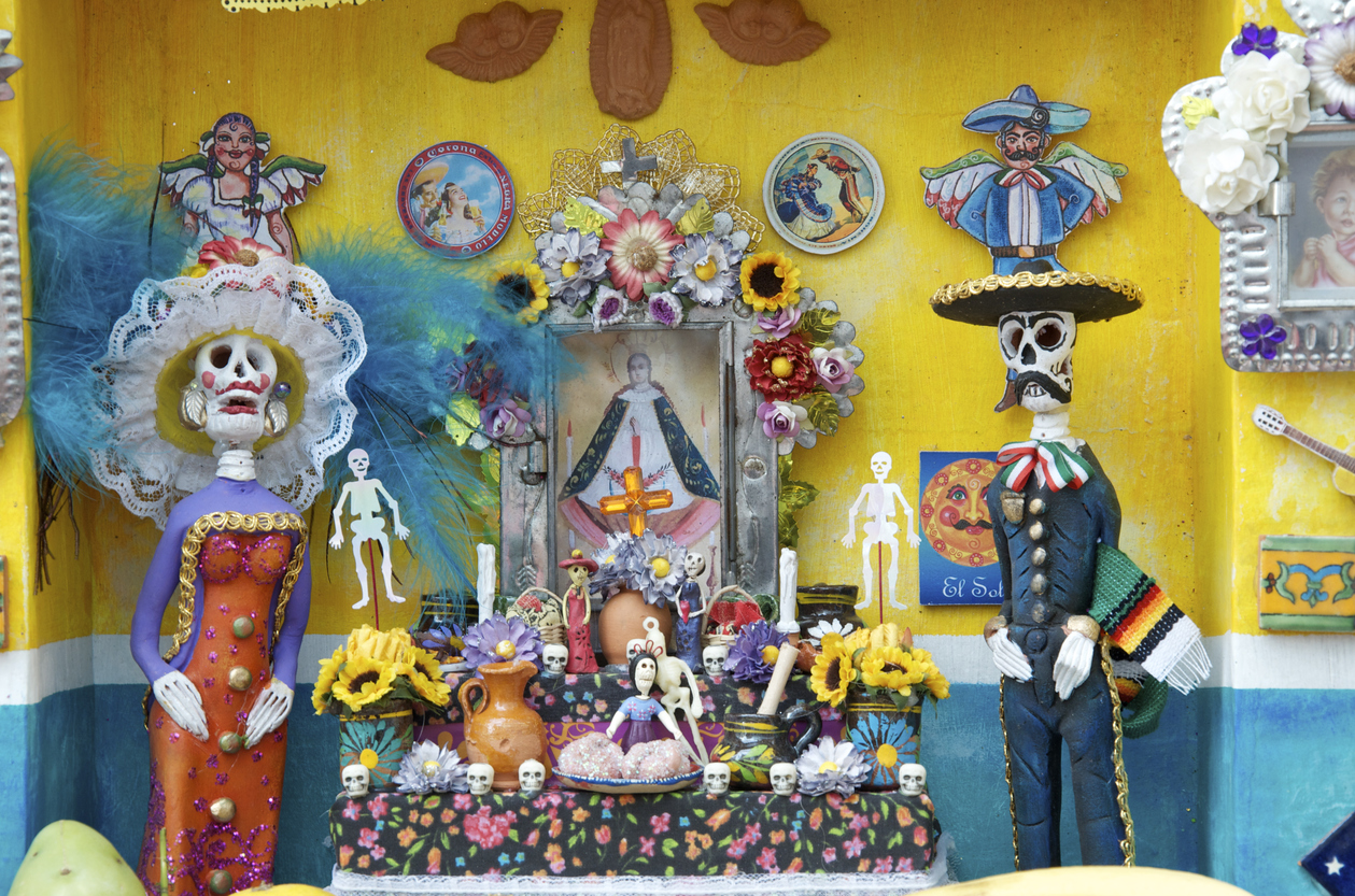 Sanctuary in honor of the dead in vibrant colors, with shades of yellow and blue, to celebrate the day of the dead in Mexico. Perhaps the most serious emblem of the holiday is the Offrenda, an altar honoring the dead. Offrendas are most often created in honor of one's ancestors or loved ones, and contain a number of traditional elements, many drawn from indigenous Mexican traditions: Crosses and other religious emblems, including statuettes of saints. Water, sacred to indigenous pre-Columbian cultures, and a symbol of baptism and new life in the Catholic church. Salt, a preservative and purifying agent. Copal, a native incense used by the Aztecs. Candles, whose light guides the dead. Flowers, particularly the Cempazúchitl, or flower of the dead- the marigold, sacred to Mictlantecuhtli, the Aztec god of the dead, they guide the spirits to their altars using their vibrant colors and scent, they also represent the fragility of life.